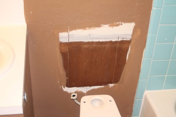 old paint behind the toilet